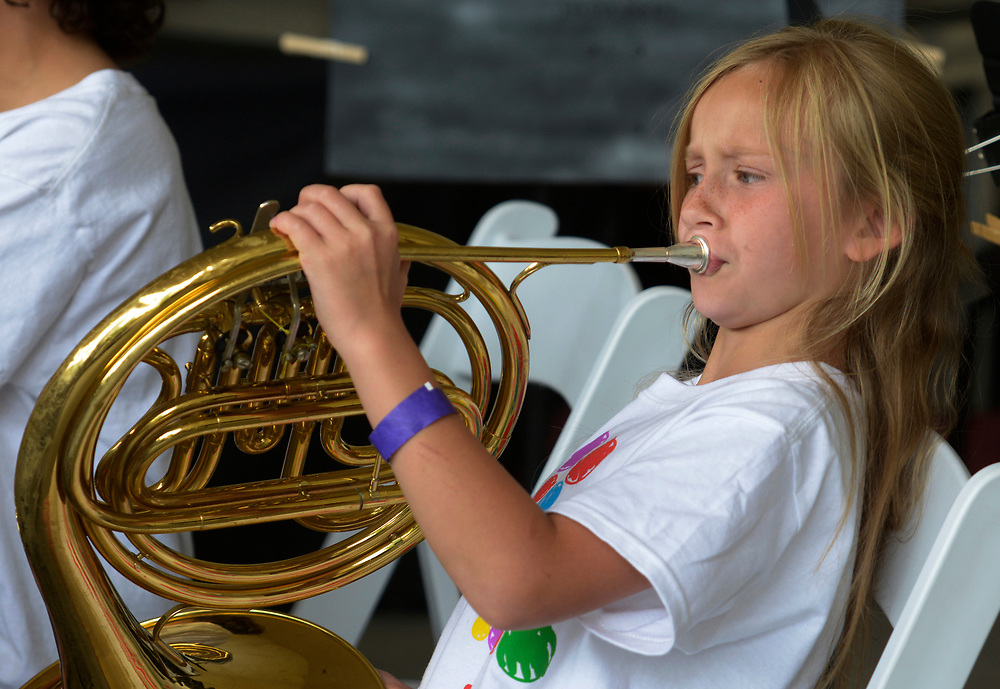 gbs051417f/ASEC -- Savannah Ricks-Johnson, 8, of Albuquerque plays the French horn with the Young Musician's Initiative during the Mother's Day Concert at the Zoo on Sunday, May 14, 2017. (Greg Sorber/Albuquerque Journal)
