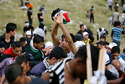 Protester carry the injured up the mountain before being taken away in an ambulance.
