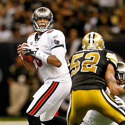 November 6, 2011; New Orleans, LA, USA; Tampa Bay Buccaneers quarterback Josh Freeman (5) throws against the New Orleans Saints during the fourth quarter of a game at the Mercedes-Benz Superdome. The Saints defeated the Buccaneers 27-16. Mandatory Credit: Derick E. Hingle-US PRESSWIRE