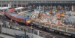 © Licensed to London News Pictures. 15/08/2017. London, UK. A derailed train rests on the wagons of a freight train at Waterloo station in London after a low speed collision. People have been advised to avoid using Waterloo station, which is undergoing major development works (R), for the remainder of the day.  Photo credit: Peter Macdiarmid/LNP