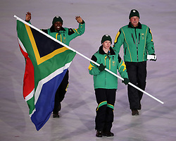February 9, 2018 - PyeongChang, South Korea - The South Africa team marches in, led by flag bearer CONNOR WILSON during the Opening Ceremony for the 2018 Pyeongchang Winter Olympic Games, held at PyeongChang Olympic Stadium. (Credit Image: © Scott Mc Kiernan via ZUMA Wire)