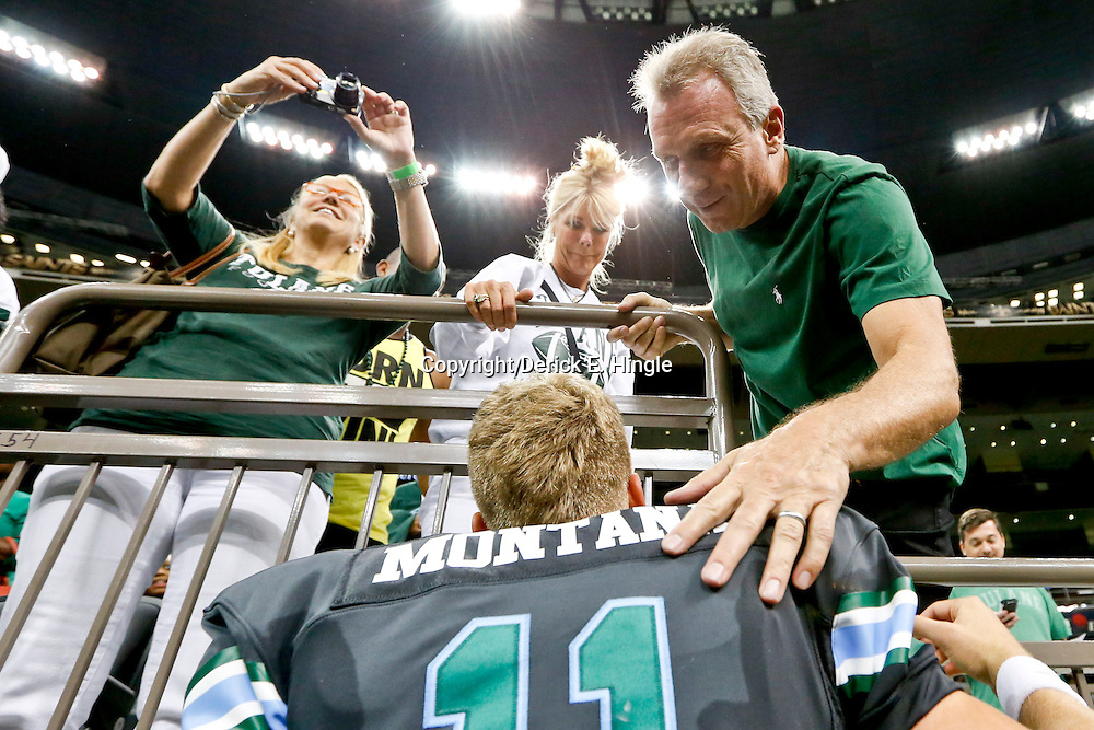 Aug 29, 2013; New Orleans, LA, USA; Tulane Green Wave quarterback Nick Montana (11) talks to his father former NFL player Joe Montana and mother Jennifer Montana following a win against the Jackson State Tigers at the Mercedes-Benz Superdome. Tulane defeated Jackson State 34-7. Mandatory Credit: Derick E. Hingle-USA TODAY Sports