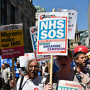 Thousands holding banner assembly at Portland Place,march to Whitehall rally NHS at 70: Free, for all, forever on June 30th, 2018.