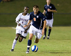 Virginia Cavaliers forward Chase Neinken (6) carries the ball up field past Hofstra defender Jamal Neptune (4).  The Virginia Cavaliers defeated the Hofstra Pride 4-2 in NCAA men's soccer at Klockner Stadium on the Grounds of the University of Virginia in Charlottesville, VA on September 7, 2008