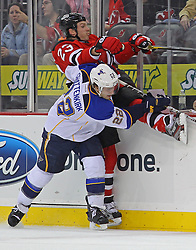 Feb 9; Newark, NJ, USA; St. Louis Blues defenseman Kevin Shattenkirk (22) hits New Jersey Devils right wing David Clarkson (23) during the second period at the Prudential Center.