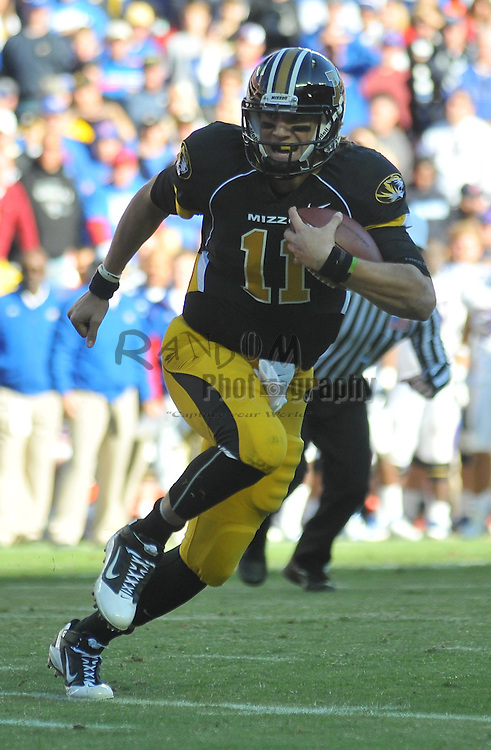 Nov 27, 2010; Kansas City, MO, USA; Missouri Tigers quarterback Blaine Gabbert (11) runs for short yardage in the second half of the game against the Kansas Jayhawks at Arrowhead Stadium. Missouri won 35-7. Mandatory Credit: Denny Medley-US PRESSWIRE