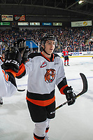 KELOWNA, BC - NOVEMBER 8:  Trevor Longo #20 of the Medicine Hat Tigers celebrates a goal with fist bumps along the bench against the Kelowna Rockets at Prospera Place on November 8, 2019 in Kelowna, Canada. (Photo by Marissa Baecker/Shoot the Breeze)