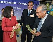Houston ISD trustee Juliet Stipeche, left, principal Eduardo Sindaco, center, and Felix Fraga, right, and share a laugh after cut the ribbon during an opening ceremony at The Rusk School, April 7, 2014.