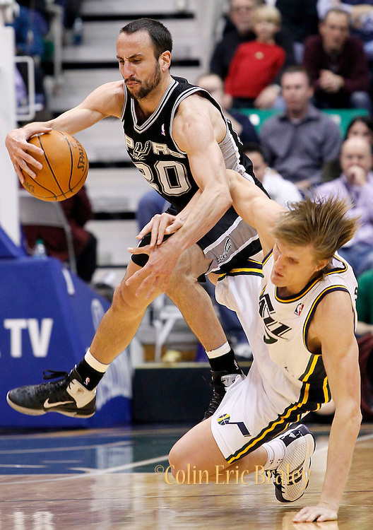 Spurs guard Manu Ginobili of Argentina, left, collides with Jazz forward Andrei Kirilenko, right, during the second half of an NBA basketball game in Salt Lake City, Wednesday Jan. 26, 2011. Kirilenko was charged with a foul on the play. Ginobili scored 26 points in the Spurs 112-105 win. (AP Photo/Colin E Braley)