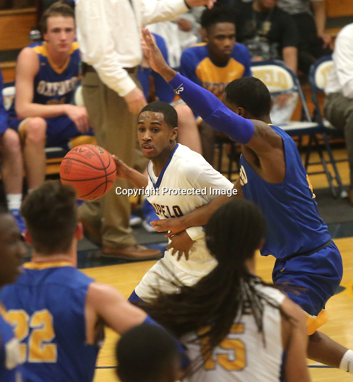 Tupelo's Keondre Hampton drives past an Oxford defender on his way to the basket Friday night.