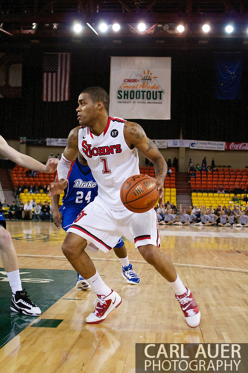 November 26th, 2010:  Anchorage, Alaska - St. John's senior guard D.J. Kennedy (1) drives in the Red Storm's semi final game of the Great Alaska Shootout against the Drake Bulldogs.  The Red Storm defense held Drake to a tournament low score as St. Johns advanced to the final game 82-39.