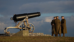 © Licensed to London News Pictures. <br /> 16/12/2014. <br /> <br /> Hartlepool, United Kingdom<br /> <br /> Members of the Commemorative Society of the 18th Battalion The Durham Light Infantry stand in front of an antique gun during an event to commemorate the bombardment of Hartlepool by German warships during World War One. During the bombardment 130 civilians were killed and more than 500 were wounded. The Headland's Heugh Gun Battery returned fire in what was the only battle to be fought on British soil during World War One, and one of the Battery's soldiers, Theo Jones of the Durham Light Infantry, became the first British soldier to be killed by enemy action on home ground in the war.<br /> <br /> Photo credit : Ian Forsyth/LNP