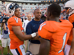 Virginia linebacker Jared Detrick (55) and Virginia cornerback Trey Womack (1) talk with former Virginia defensive coordinator and now Richmond head coach Mike London after the game.  The Virginia Cavaliers defeated the #3 ranked (NCAA Division 1 Football Championship Subdivision) Richmond Spiders 16-0 in a NCAA football game held at Scott Stadium on the Grounds of the University of Virginia in Charlottesville, VA on September 6, 2008.