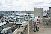 Nairobi, Kenya -   2015-04-02  -  Charles Kinyua, 7, playing with a ball with teacher Samuel Mwangi on the roof of his apartment building in the Makuru slum of Nairobi, Kenya on April 2, 2015. Charles has been taught basic communication skills by CBR program workers. Photo by Daniel Hayduk
