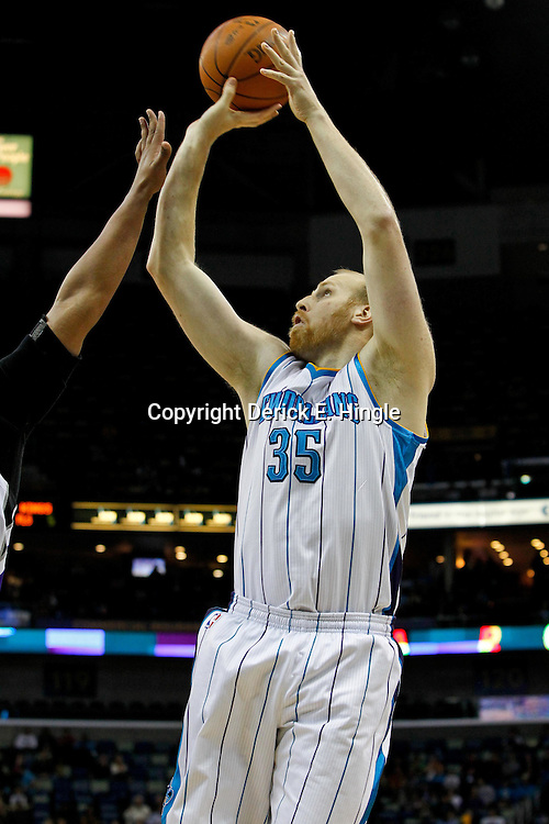 February 6, 2012; New Orleans, LA, USA; New Orleans Hornets center Chris Kaman (35) shoots against the Sacramento Kings during the first quarter of a game at the New Orleans Arena.   Mandatory Credit: Derick E. Hingle-US PRESSWIRE