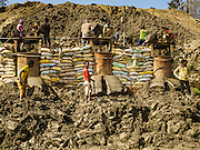 03 MARCH 2017 - BAGMATI, NEPAL:  Clay is pushed out of hillside to make bricks at a brick factory in Bagmati, near Bhaktapur. There are almost 50 brick factories in the valley near Bagmati. The brick makers are very busy making bricks for the reconstruction of Kathmandu, Bhaktapur and other cities in the Kathmandu valley that were badly damaged by the 2015 Nepal Earthquake. The brick factories have been in the Bagmati area for centuries because the local clay is a popular raw material for the bricks. Most of the workers in the brick factories are migrant workers from southern Nepal.      PHOTO BY JACK KURTZ