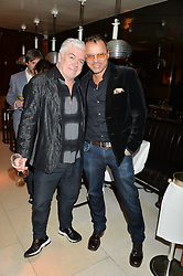Left to right, TIM BLANKS and GERRY DEVEAUX at a dinner to celebrate the publication of Obsessive Creative by Collette Dinnigan hosted by Charlotte Stockdale and Marc Newson held at Mr Chow, Knightsbridge, London on 9th February 2015.