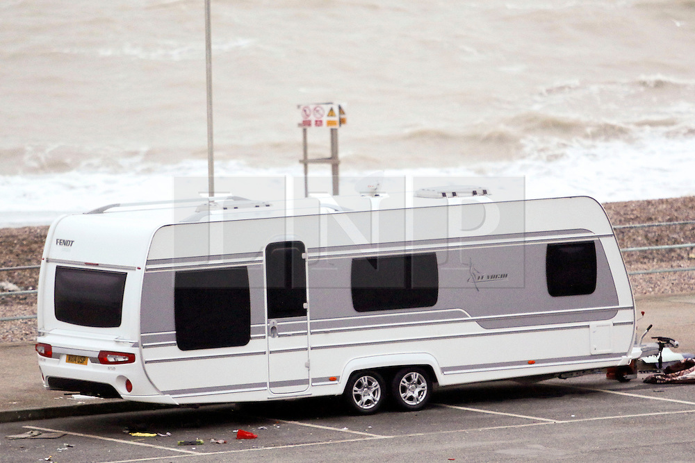 © Licensed to London News Pictures. 14/01/2015. Brighton, UK. Whilst some remain a few of the travellers have moved on leaving behind them littler and empty gas canisters. A group of travellers with caravans that moved on to a public space on Black Rock near Brighton Marina have been issued with a Claim Form for Possession of Property on January 14th 2015 after requests from the council to vacate the public space.  Several large rubbish bins have been tipped over with waste and empty gas bottles left lying all over Black Rock and Brighton Beach. Photo credit : Hugo Michiels/LNP