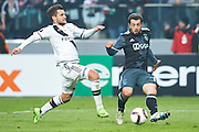 Warsaw, Poland - 2017 February 16: (R) Amin Younes of Ajax Amsterdam fights for the ball with (L) Lukasz Broz of Legia Warsaw during soccer match Legia Warszawa v Ajax Amsterdam - UEFA Europe League  at Municipal Stadium on February 16, 2017 in Warsaw, Poland.<br /> <br /> Mandatory credit:<br /> Photo by &copy; Adam Nurkiewicz / Mediasport<br /> <br /> Adam Nurkiewicz declares that he has no rights to the image of people at the photographs of his authorship.<br /> <br /> Picture also available in RAW (NEF) or TIFF format on special request.<br /> <br /> Any editorial, commercial or promotional use requires written permission from the author of image.
