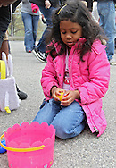 Elaina Flores, 6, of Cedar Rapids works on opening her eggs after the Church Easter Egg Hunt at Hillside Wesleyan Church, 2600 1st Ave NW, in Cedar Rapids on Saturday morning, March 31, 2012. This year there were over 7,500 eggs up for grabs. (Stephen Mally/Freelance)