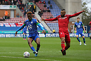 Wigan Athletic forward Jamal Lowe (9) and Nottingham Forest midfielder John Bostock (13) during the EFL Sky Bet Championship match between Wigan Athletic and Nottingham Forest at the DW Stadium, Wigan, England on 20 October 2019.