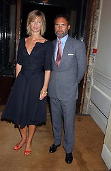 MR ADRIAN GILL and MISS NICOLA FORMBY at a party hosted by Dom Perignon and Vanity Fair magazine to celebrate the launch of a unique collection of essays based on the theme of seduction to raise money for the charity English Pen. The paty was held at the Dom Perignon Mallroom,  13 Grosvenor Crescent, London W1 on 8th September 2004.