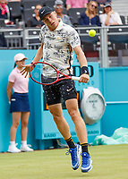 Tennis - 2019 Queen's Club Fever-Tree Championships - Day Three, Wednesday<br /> <br /> Men's Singles, First Round: Juan Martin Del Potro (ARG) Vs. Denis Shapovalov (CAN)<br /> <br /> Denis Shapovalov (CAN) with a block return on Centre Court.<br />  <br /> COLORSPORT/DANIEL BEARHAM