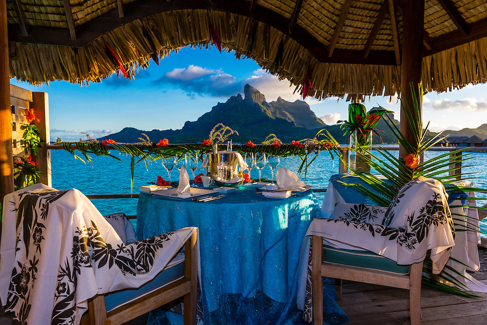 Romantic private catered dinner on the deck of an overwater bungalow, Four Seasons Resort Bora Bora, French Polynesia.