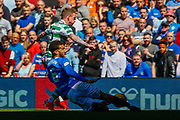 Connor Goldson of Rangers FC with a challenge on Jonny Hayes during the Ladbrokes Scottish Premiership match between Rangers and Celtic at Ibrox, Glasgow, Scotland on 12 May 2019.