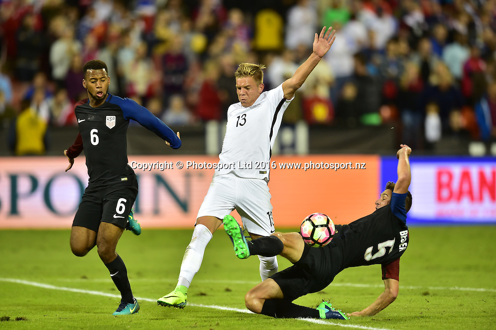 New Zealand's Monty Patterson challenges for possession with Kellyn Acotsta and Matt Besler of USA.<br /> Washington, D.C. - October 11, 2016: The U.S. Men's National team and New Zealand are all even 0-0 in first half play in an international friendly game at RFK Stadium.<br /> Copyright photo: Brad Smith / www.photosport.nz