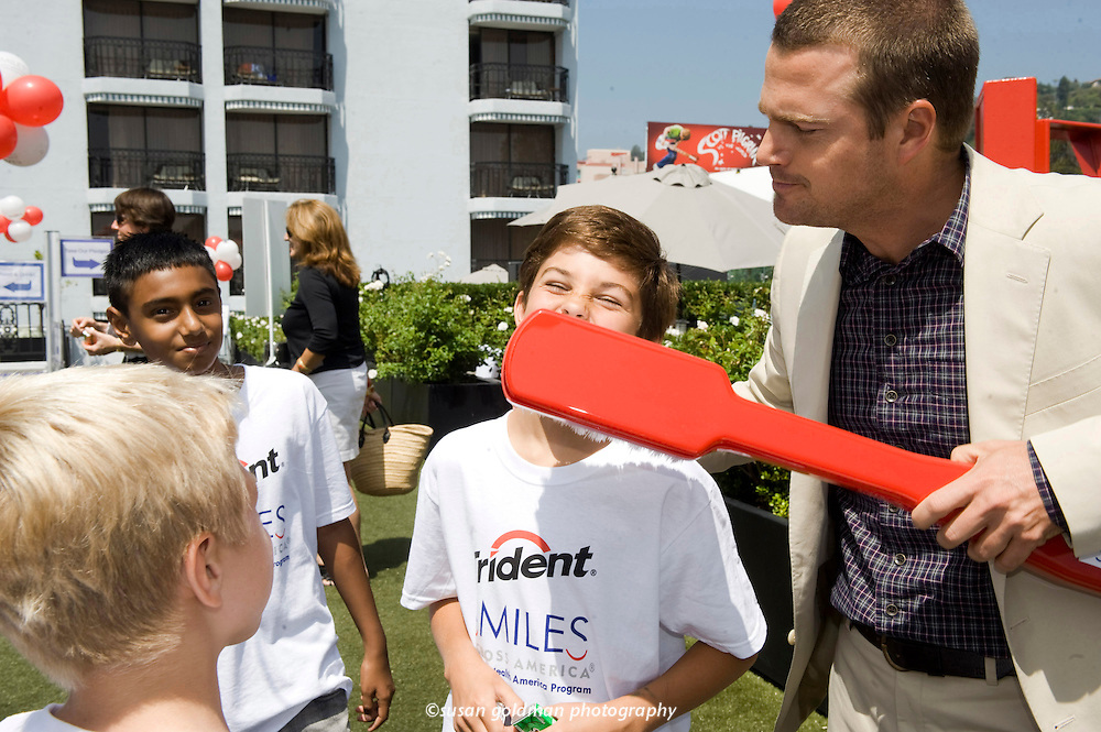 Actor Chris O'Donnell lends a hand to Ethan McCarthy to help promote healthy smiles at the Trident and Smiles Across America  campaign kick-off event in West Hollywood, Calif. Tooth decay is the most common chronic childhood disease in America and for each pack of Trident gum purchased from Sept. 13 to Sept. 19, Trident will donate five cents to help SAA provide dental care to children in need. Photo/Trident, Susan Goldman.