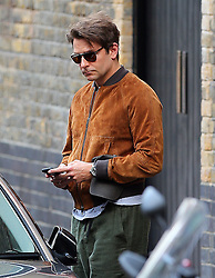 (EXCLUSIVE PICTURES) Actor Bradley Cooper wearing sunglasses, suede bomber jacket and a pair of green trousers at the Chiltern Firehouse in London, UK. 28/07/2015<br />