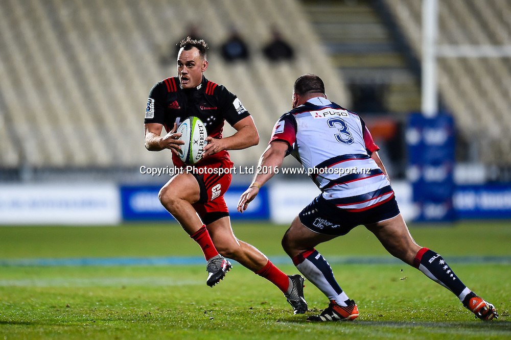 Israel Dagg of the Crusaders eludes Laurie Weeks of the Rebels during the Super Rugby Match, Crusaders V Rebels, AMI Stadium, Christchurch, New Zealand. 9th July 2016. Copyright Photo: John Davidson / www.photosport.nz
