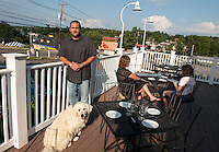 Richard Ray Proprietor and his dog Madison on the deck of the Lobster Pound Restaurant and Lounge at Weirs Beach.   (Karen Bobotas/for the Laconia Daily Sun)