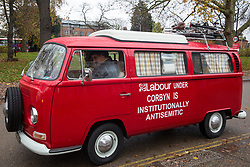 London, UK. 26 November, 2019. A vehicle bearing the words 'Labour under Corbyn is Institutionally Antisemitic parked outside the Bernie Grant Arts Centre in Tottenham before the arrival of Labour Party leader Jeremy Corbyn to launch Labour's new Race and Faith Manifesto.