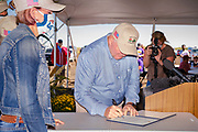 03 SEPTEMBER 2020 - RADCLIFFE, IOWA: SONNY PERDUE, the US Secretary of Agriculture, announces a secretarial disaster declaration for 42 counties in central Iowa during a farm visit in central Iowa Thursday. Perdue was accompanied by Governor Kim Reynolds and US Senator Joni Ernst. The secretarial disaster declaration frees up more federal funds, from the Department of Agriculture, to help in recovery from the derecho storm that wiped out about one-third of Iowa's corn crop on Monday, August 10, 2020. Many Iowa farmers are still rebuilding lost buildings or plowing under lost crops.        PHOTO BY JACK KURTZ
