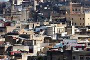 FEZ, MOROCCO 3rd FEBRUARY 2018 - Urban cityscape skyline of clustered rooftops in the old Fez Medina, Middle Atlas Mountains, Morocco.