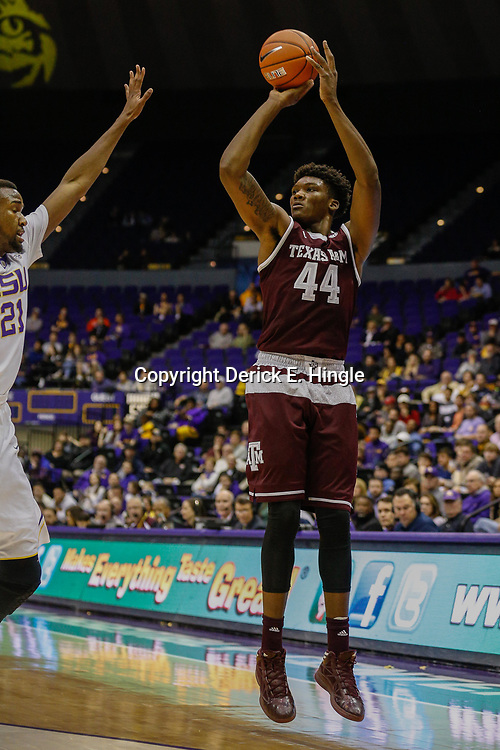 Feb 4, 2017; Baton Rouge, LA, USA; Texas A&M Aggies forward Robert Williams (44) shoots over LSU Tigers forward Aaron Epps (21) during the first half at the Pete Maravich Assembly Center. Mandatory Credit: Derick E. Hingle-USA TODAY Sports