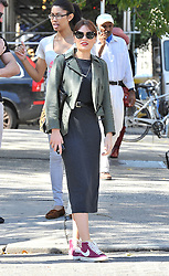 (UK RIGHTS ONLY) Singer Jessie J wearing dark shades, large hoop eaarings, green jacket, long grey dress and a pair of Nike Blazers boots, out with friends in New York, USA. 05/10/2012<br />BYLINE MUST READ : EAGLEPRESS/GOTCHA IMAGES<br /><br />Copyright by © Gotcha Images Ltd. All rights reserved.<br />Usage of this image is conditional upon the acceptance <br />of Gotcha Images Ltd, terms and conditions available at<br />www.gotchaimages.com