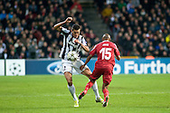 23.10.12. Copenhagen, Denmark. UEFA Champions League Group E, FC Nordsjaelland  1 vs Juventus 1 at the Parken Stadium. Lucio (L) of Juventus fights for the ball with John (R) of FC Nordsjaelland during the UEFA Champions League. Photo: © Ricardo Ramirez..