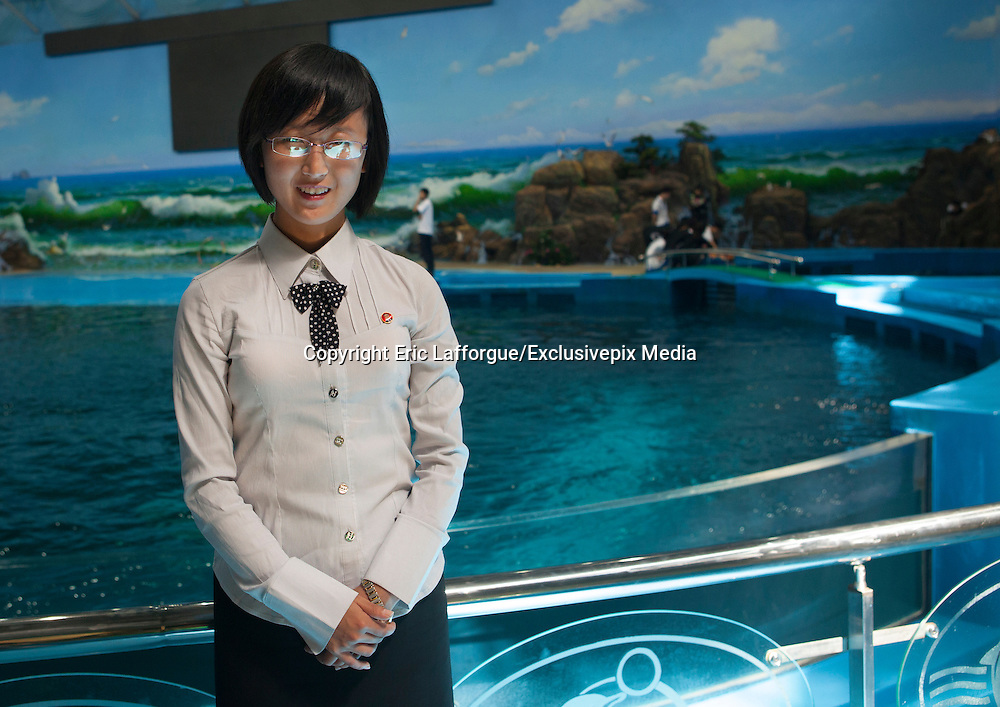 I'm 20, I'm North Korean<br /> <br /> Miss Kim is 20. She lives in Pyongyang, North Korea's display window. She's studying<br /> English. First of her class, she was lucky enough to come with me during my 6th trip to<br /> North Korea as an assistant guide. She had never previously left Pyongyang. It was a<br /> unique opportunity for her to visit her own country and to get to meet and speak to a<br /> foreigner. She was shy at first, but became quite talkative as the days went on, and<br /> describe to me the everyday lives of young North Koreans. Without ever crossing over<br /> the Party line...<br /> Small chats between friends who will never meet again…<br /> <br /> <br /> -Do you know Michael Jackson? -I have heard of him, yes.<br /> -And Lady Gaga?<br /> -I don't know who he is, no...<br /> <br /> -Why doesn't English or American pop music reach your country?<br /> -Mr Eric, because it is not what we like to listen to... But we know Mozart, Bach and Beethoven!<br /> <br /> -Why do boys and girls not dance together?<br /> -They are shy, do you dance with girls that you don't know Mr.Eric?<br /> <br /> -What is the criteria for beauty in North Korea?<br /> -Mr Eric, a woman should have big eyes, a high nose, a small mouth and a white skin, and she should not be skinny. Women in North Korea are truely beautiful flowers.<br /> <br /> -Do women find Kim Jong Un handsome? -Mr Eric, that's an outrageous question.<br /> <br /> -Nobody dyes their hair in North Korea?<br /> -No. We need to respect the haircut regulation, we have a lot of choice! -But don't you want to have the haircut you want?<br /> -No, that's the last thing we're concerned about.<br /> <br /> -Do you have any idea of the lastest European fashions? -No, Mr. Eric.<br /> -Young people buy jeans in which there are holes. -Holes?<br /> -Yes, they buy worn jeans or which have been ripped. -I don't believe you Mr.Eric, you are joking.<br /> <br />  -Do you know the name of this character on the tshirt? -No Mr Eric. It's just a mouse. It's Chinese!<br /> <br /> <br /> -Is this a computer, Mr Eric?<br /> -No.This is an ipad. You can listen to music, watch videos, and check emails.<br /> -Really?<br /> -It even has an applicatio