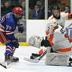 COCHRANE, ON - MAY 4: Nicholas Tallarico #29 of the Hearst Lumberjacks makes the save on Spenser Kersten #77 of the Oakville Blades during the third period on May 4, 2019 at Tim Horton Events Centre in Cochrane, Ontario, Canada.<br /> (Photo by Tim Bates / OJHL Images)