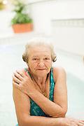 HOT SPRINGS, AR – JUNE 28, 2013: An elderly woman enjoys a natural hot bath at the Quapaw Baths spa on historic Bathhouse Row.