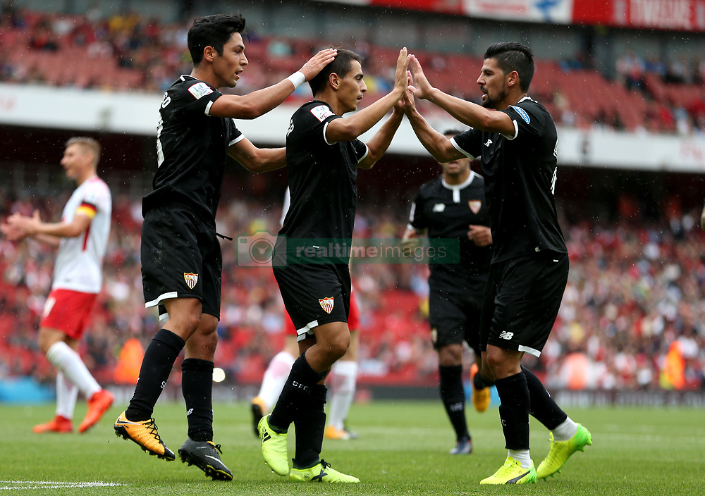 Sevilla's Wissam Ben Yedder (centre) celebrates scoring his side's first goal of the game from the penalty spot