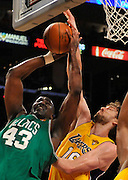 Celtics Kendrick Perkins does battle with Lakers Pau Gasol in the 2nd quarter. The Lakers defeated the Boston Celtics in game 6 of the NBA Finals 89-67. Los Angeles, CA 06/15/2010 (John McCoy/Staff Photographer).