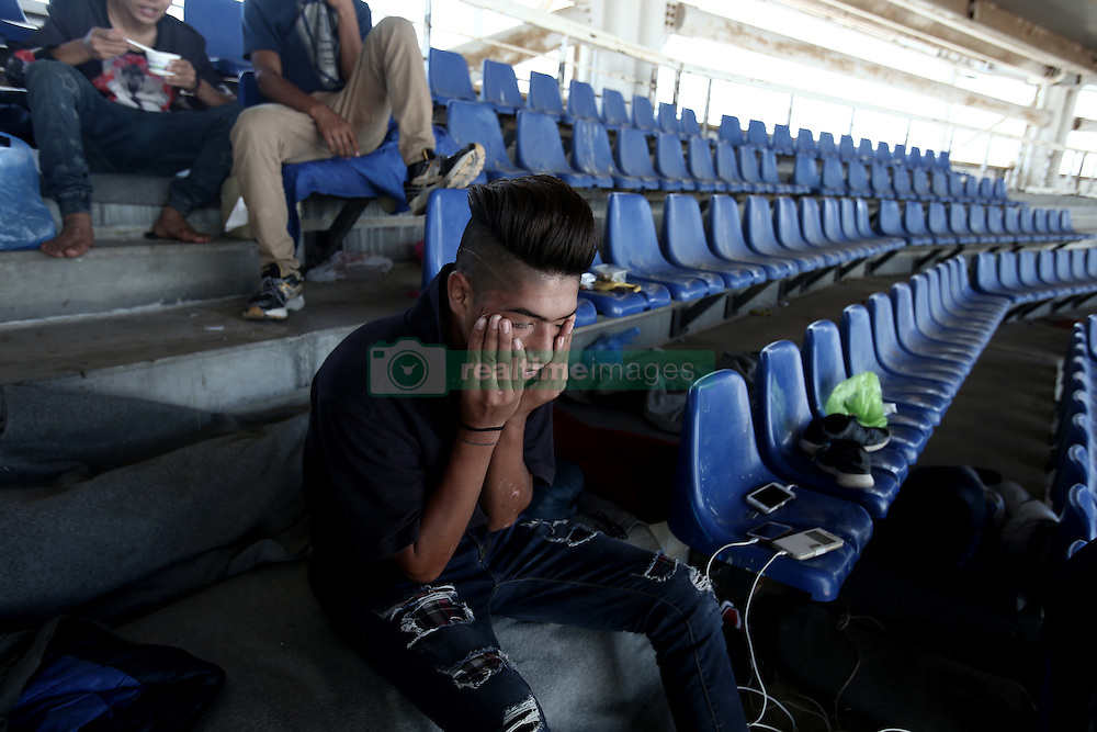 October 5, 2016 - Athens, Greece - Regugees and migrants in a sports facility in the olympic complex at the former Athens airport of Athens, Greece on October 5, 2016.Almost 2,500 migrants and refugees, mainly Afghani, are housed at the former Athens airport site, and to an olympic complex used in the 2004 Olympics. In total 60.736 refugees and other migrants are stranded in Greece. (Credit Image: © Panayiotis Tzamaros/NurPhoto via ZUMA Press)