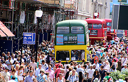 © Licensed to London News Pictures. 22/06/2014, UK. The hot sunny weather attracts crowds to the London Transport Museum Regent Street Bus Cavalcade. In celebration of the Year of the Bus, almost 50 buses from the earliest horse-drawn model of the 1820s right up to the New Routemaster of the present transformed Regent Street in the heart of Londonís West End, 22 June 2014. Photo credit : Richard Goldschmidt/Piqtured/LNP