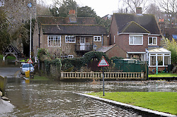 © Licensed to London News Pictures. 28/01/2014<br /> Wet and cold weather conditions continue across the UK.<br /> The river Darent water level in Eynsford,Kent remain high flooding parts of the Riverside at the Ford. <br /> Photo credit :Grant Falvey/LNP