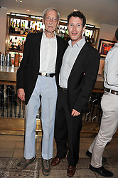 Left to right, Great Train robber and writer BRUCE REYNOLDS and actor NICK MORAN at a party to celebrate the publication on The House of Rumour by Jake Arnott held at The Ivy Club, West Street, London on 9th July 2012.