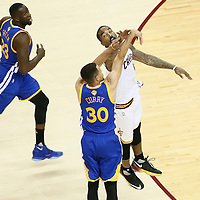 10 June 2016: Golden State Warriors guard Stephen Curry (30) takes a jump shot over Cleveland Cavaliers guard J.R. Smith (5) during the Golden State Warriors 108-97 victory over the Cleveland Cavaliers, during Game Four of the 2016 NBA Finals at the Quicken Loans Arena, Cleveland, Ohio, USA.